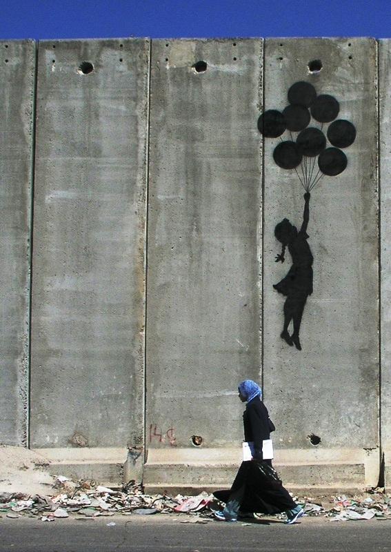 http://revolutionaryfrontlines.files.wordpress.com/2010/07/banksy-westbank-wall-balloon-girl.jpg