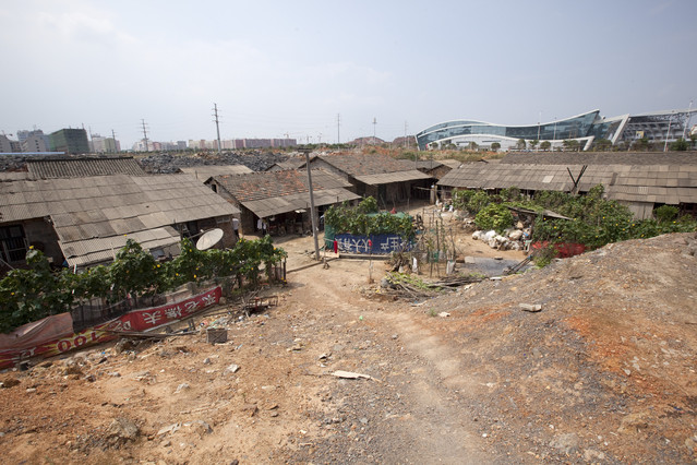 Loudi China  city photo : ... project rises behind the Li family's housing in Loudi, Hunan Province