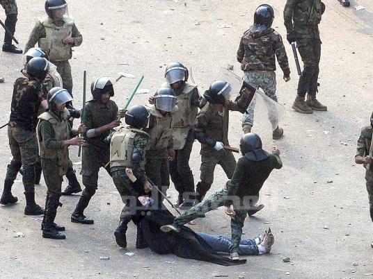 BEAT DAT Egyptian police strip woman video