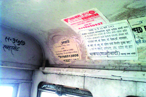 CPI (Maoist) poster in a PMPML bus