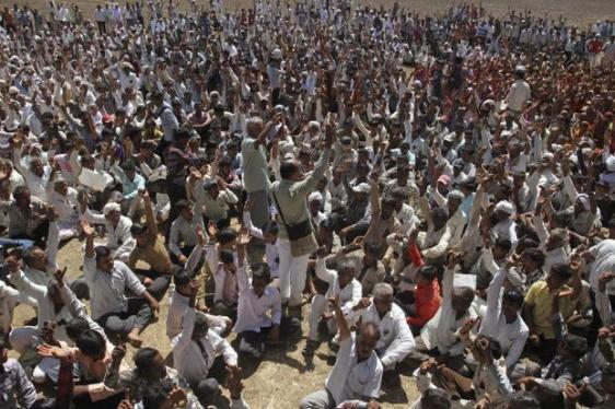 Villagers shout slogans after boycotting a public hearing for a proposed nuclear plant, near Bhavnagar, Gujarat, on Tuesday. Photo: AP Photo/Ajit Solanki
