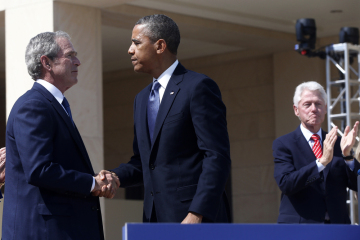 President Barack Obama shakes hands with former President George W. Bush, as former President Bill Clinton applauds at right after Obama spoke at the dedication of the George W. Bush presidential library on the campus of Southern Methodist University in Dallas, April 25, 2013.
