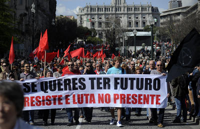 "Workers hold a banner that reads ""If you want to have a future, resist and fight at the present time"" during a May Day workers demonstration in Porto, Portugal Wednesday May 1, 2013. In Portugal, with unemployment at 17.5 percent in March, the government is seeking to agree new austerity measures after its Constitutional Court rejected as discriminatory cuts to civil servant salaries and pensions decided in response to demands by EU-IMF lenders. (AP Photo/Paulo Duarte) ( Paulo Duarte )"