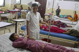 Bangladeshi garment workers who fell ill during their shifts at a sweater factory lie on beds at a hospital on the outskirts of Dhaka, Bangladesh, June 6, 2013. About 450 garment workers fell ill at the Starlight Sweater Factory near Bangladesh's capital, due to possible water contamination.  --   A.M. Ahad/AP