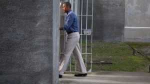Barack Obama making a highly-publicised visit to Nelson Mandela's 1980's prison cell on Robben Island