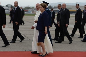 In this photo provided by the Vatican newspaper L'Osservatore Romano on Tuesday, July 23, 2013, Pope Francis shares a word with Brazil's President Dilma Rousseff during a welcome ceremony at Guanabara Palace in Rio de Janeiro, Brazil, Monday, July 22, 2013. Pope Francis returned to his home continent for the first time as pontiff, embarking on a seven-day visit meant to fan the fervor of the faithful around the globe.  (AP Photo/L'Osservatore Romano, ho)