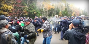 Police cars explode in an anti-fracking protest