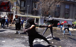 Some of the protesters threw rocks and other objects at police after the main, peaceful march earlier Saturday.  Luis Hidalgo/AP