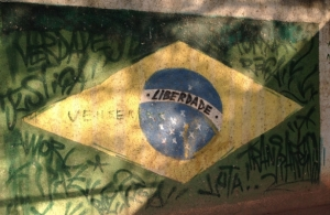 "Graffiti on the walls of Vila Autódromo. On the Brazilian flag, instead of ""order and progress"", ""freedom"" is written across the iconic blue globe. June 17, 2014. (Photo by the author)"